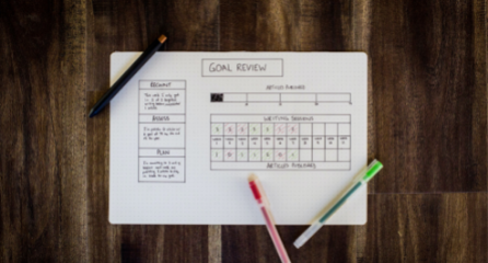 Goal worksheet on table with pens